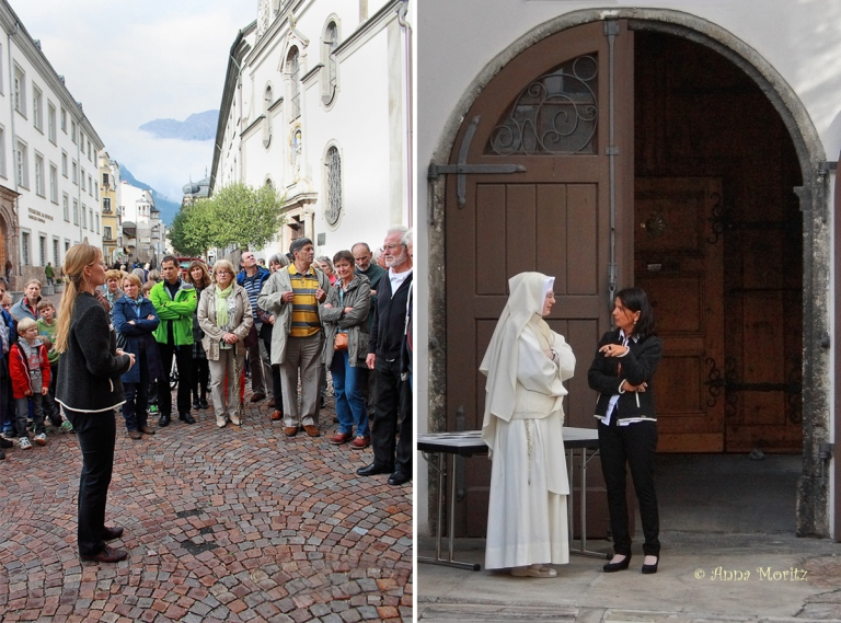 The tour guide , one of the seven nuns , in conversation with an employee of the tourist board