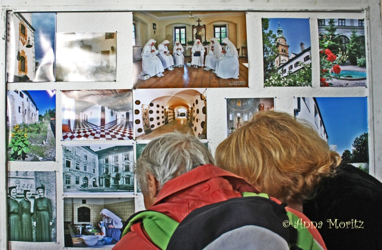 Visitors looking at the information board in the convent